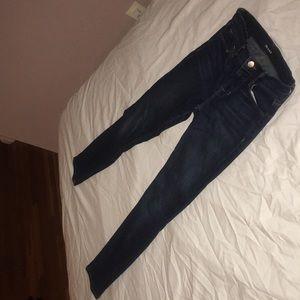 Skinny dark blue jeans